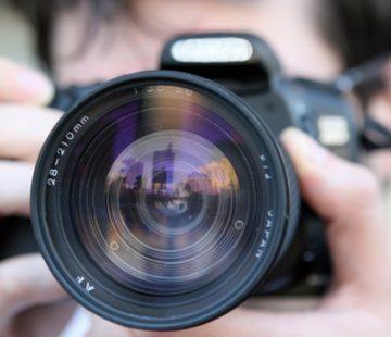 Valokuvaaja ja kamera